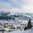 Mountain village in snow — Stock Photo