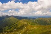 Touristsng on mountain walk — Stock Photo