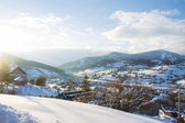 Sunlight in mountain winter village — Stock Photo