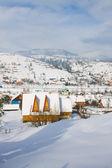 дома в зимние горы — Стоковое фото