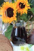 Jug and a glass of kvas — Stock Photo