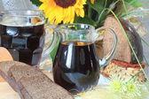 Jug and mug of kvass — Stock Photo