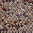 Detail-of-an-ancient-undamaged-stony-wall-in-Pompei — Stock Photo