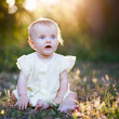 Portrait of a happy little girl in the park — Stock Photo #21423077