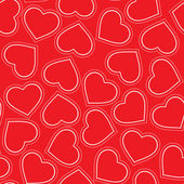Seamless pattern of red hearts — Stock Vector