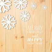 Wood board with white snow and stars. — Stock Vector