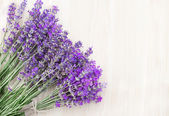 Lavender on a wooden desk. — Stock Photo