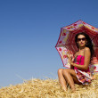 Stylish girl in rye under umbrella — Stock Photo