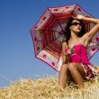 Stock Photo: Girl with sunshade