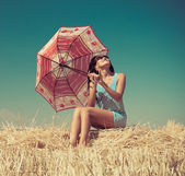 Beautiful girl waiting for the rain — Stock Photo