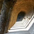 Stock Photo: Stone corridor with sunshine in Parc Güell, Barcelona, spain