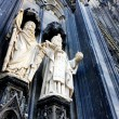 Two sacred sculptureon Cologne Cathedral - Stock Photo