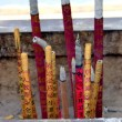 Burn joss sticks in Chinese temple — Stockfoto #12835745