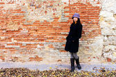 Girl with brick wall — Stock Photo