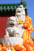 Chinese stone lions in a line — Stock Photo