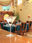 Martini glass on the bar — Stock Photo