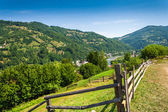 Wooden fence in mountains — Stock Photo