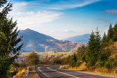 Road in high mountains — Stock Photo