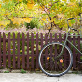 Bicycle and fence — Stock Photo