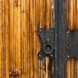 Door lock on a wooden coating — Stock Photo
