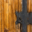 Door lock on wooden coating — Stock Photo #23727099
