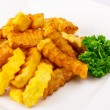 Fried sliced curly sticks potatoes — Stock Photo #24349367
