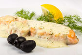 Fillet of salmon sauce with black olives — Stock Photo