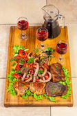 Grilled meat, sausages and herbs with wine — Stock Photo
