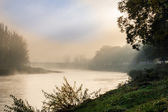 Fog in autumn on the river — Stock Photo