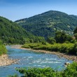 Stock Photo: River meanders at the mountain foot