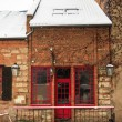 Red door pub in winter — Stock Photo