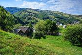 Village on a mountain slopes — Stock Photo