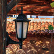 Lantern in summer terrace shade — Stock Photo