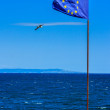 European flag on strengthening, next to the sea border. — Stock Photo