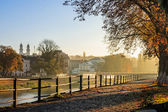 Autumn morning on old town embankment filled with light — Stock Photo