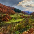 Nullah near village in autumn mountain landscape — Stock Photo