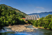 Metal bridge over the river in the mountains — Stock Photo