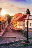 Curve cobbled streets of the old town goes down — Stock Photo