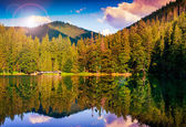 Mountain lake in evening — Stock Photo