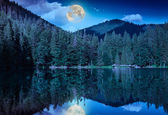 Midnight mountain lake — Stock Photo