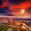 Light on stone mountain slope with forest at sunset — Stock Photo #37548671
