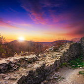 Ruins of an old castle in the mountains in evening — Stock Photo