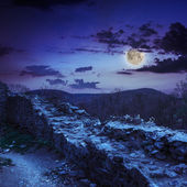 Ruins of an old castle in the mountains at night — Stock Photo
