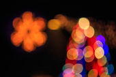 Abstract background of blurred lights with bokeh effect — Stock Photo