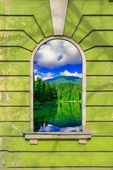 Old window frame with picture — Stockfoto