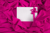 Love card with ribbon on a purple fabric — Stock Photo