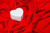 Love card with heart on a red fabric — Stockfoto
