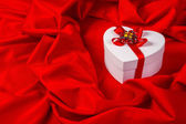 Love card with heart on a red fabric — Foto Stock