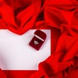Love card with diamond ring on a red fabric — Stock Photo #39341467