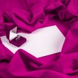 Love card with diamond ring on a purple fabric — Stock Photo #39397533